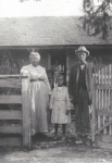 Henry and Louella with their granddaughter Sadie (daughter of Millard and Janie). The two people in the doorway maybe Am